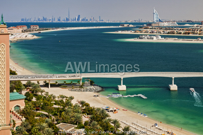 View from the 5 star luxury Atlantis Resort Hotel, out over the Palm Jumeriah Lagoon, the Palm Atlantis Monorail and  looking towards the Burj Al Arab and downtown Dubai, The Palm Jumeriah, Dubai, United Arab Emirates.