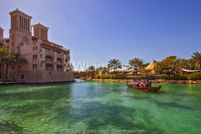 A replica dhow water taxi on the waterways surrounding the Madinat Jumeirah 5 star hotel, Jumeirah, Dubai, United Arab Emirates.