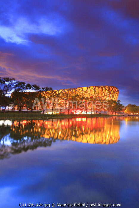 China, Beijing, Olympic park and famous bird's nest stadium made of steel illuminated by a colorful sunset