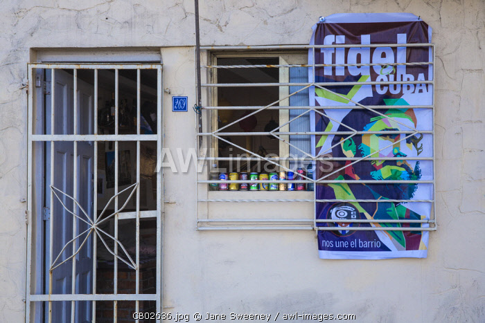 Cuba, Havana, Buildings on The Malecon, Poster of Fidel on shop wall after the death of Fidel Castro in 2016