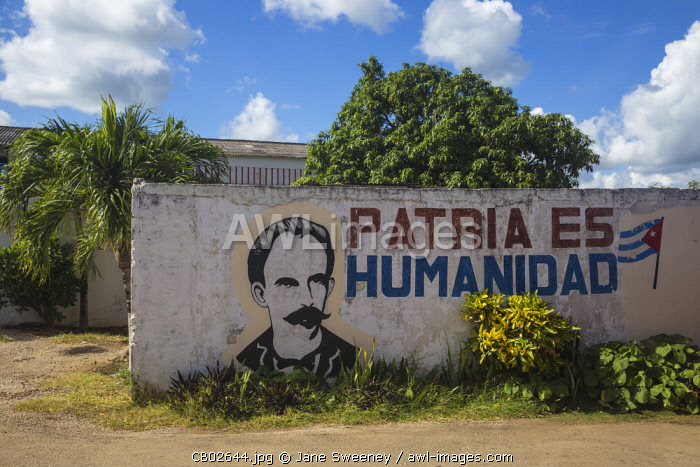 Cuba, Villa Clara province, Remedios, Bus station, Revolutionary slogan painted on wall, saying Patria Es Humanidad, - fatherland is humanity