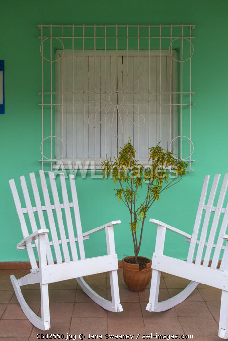 Cuba, Pinar del Río Province, Vinales,  Vinales town, Rocking chairs outside house