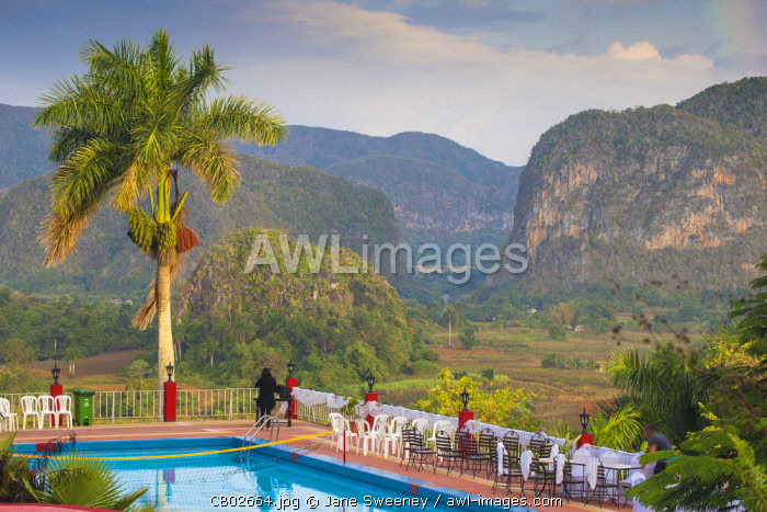 Cuba, Pinar del Río Province, Vinales, View over Hotel Horizontes Los Jazmines swimming pool to Vinales valley - set up for a wedding party