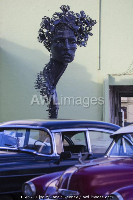 Cuba, Havana, The Malecon, Classic America  cars infront of statue