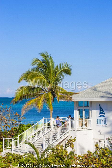 Caribbean, Bahamas, Providence Island, People sitting on balcony of Blue Sail restaurant