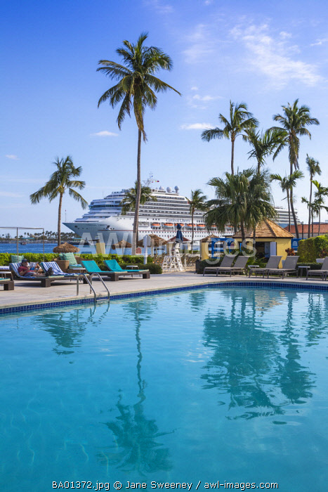Caribbean, Bahamas, Providence Island, Nassau, Swimming pool at British Colonial Hilton Hotel with Cruise ship passing by