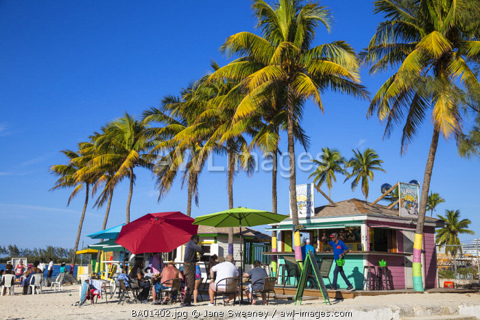 Caribbean, Bahamas, Providence Island, Nassau, Junkanoo beach, Colourful wooden huts serving Bahamian food and drink
