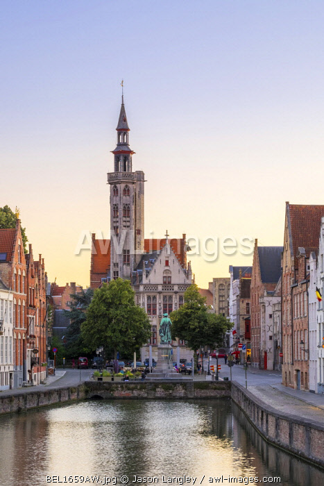 Belgium, West Flanders (Vlaanderen), Bruges (Brugge). The Burghers' Lodge (Poortersloge) and Jan van Eyckplein on the Spiegelrei (Spinolarei) canal at sunset.