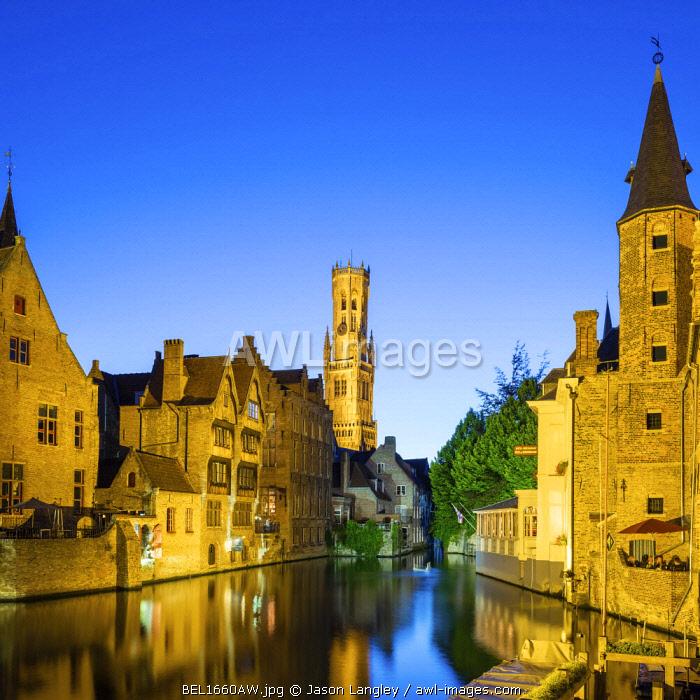 Belgium, West Flanders (Vlaanderen), Bruges (Brugge). Belfort van Brugge and medieval buildings on the Dijver canal from Rozenhoedkaai at dusk.