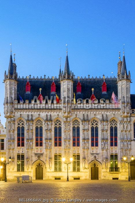 Belgium, West Flanders (Vlaanderen), Bruges (Brugge). Stadhuis van Brugge city hall on Burg Square at dusk.