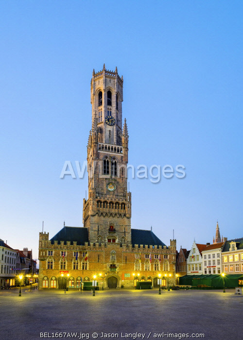 Belgium, West Flanders (Vlaanderen), Bruges (Brugge). The 13th century Belfort van Brugge belfry tower on the Markt square, at dusk.