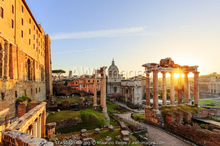 Italy, Rome, Colosseum and Roman Forum at sunrise