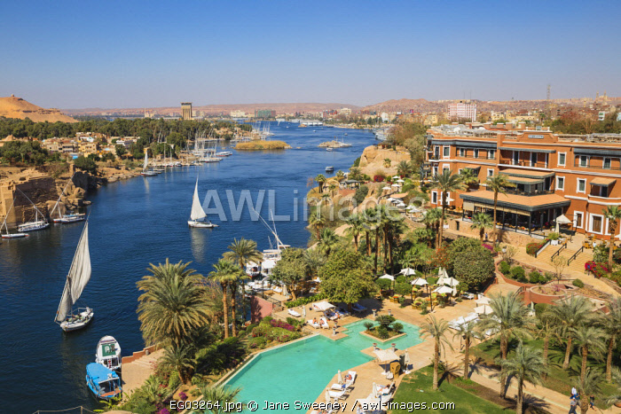 Egypt, Upper Egypt, Aswan, View of Sofitel Legend Old Cataract hotel and swimming pool situated on the banks of the river Nile