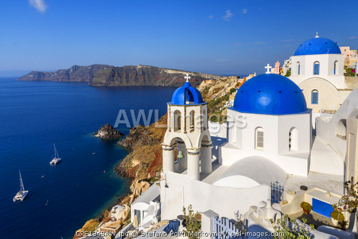 awl-images.com - Greece / Church with blue domes in Oia, Santorini, South Aegean, Greece