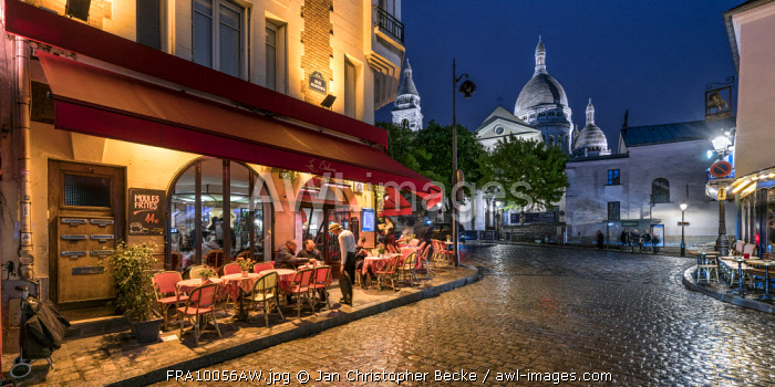 Montmartre at night with illuminated Sacre Coeur Basilica in the background, Paris, France