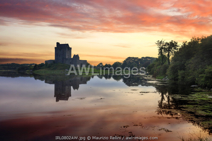 Europe, Dublin, Ireland, Dunguaire castle in Kinvara village at sunrise reflecting in the ocean
