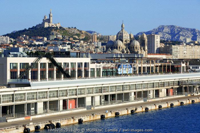 France, Bouches du Rhone, Marseille, Euromediterranean area, La Joliette district, dock Lazaretto, the Terrasses du Port, Notre Dame de la Garde and Cathedral in the background The Major