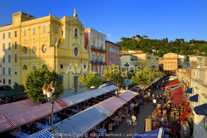 France, Alpes Maritimes, Nice, old town, cours Saleya market, Chapel of Mercy (18th century) left and the Cais de Pierlas palace in the background