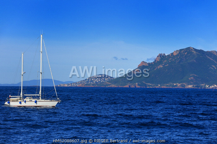 France, Alpes Maritimes, sailboat off the Lerins Islands and the Esterel Mountains in the background