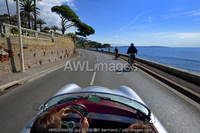 France, Alpes Maritimes, Cannes, on the Boulevard Eugene Gazagnaire along the coast aboard a collection convertible Porsche Speedster 356