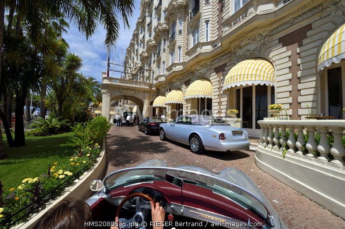 France, Alpes Maritimes, Cannes, the Carlton palace on the boulevard de la Croisette, aboard a collection convertible Porsche Speedster 356