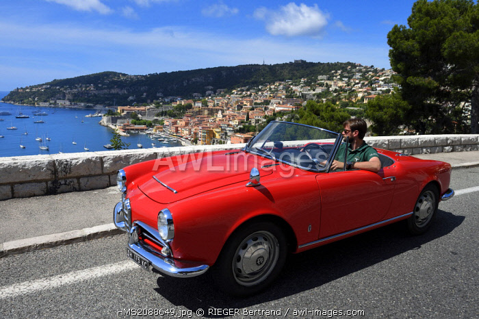 France, Alpes Maritimes, Villefranche sur Mer, collection convertible Alfa Romeo Giulietta on the Basse Corniche road overlooking the city (Compulsory mention: Company Rent a Classic Car)