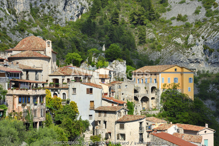France, Alpes Maritimes, the hilltop village of Peille, the Chapel of St. Sebastian (town hall), the War Memorial and the Palais Lascaris, right on the edge of the cliff