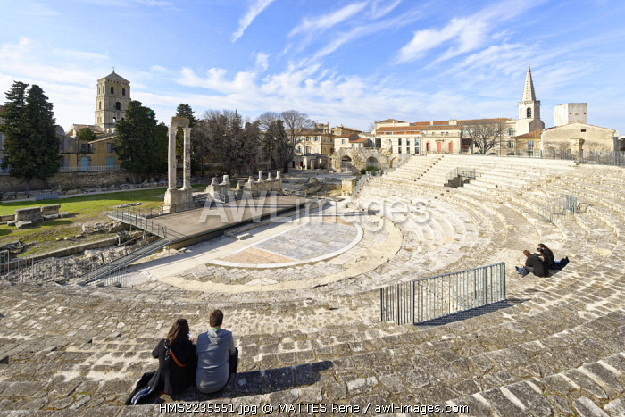 France, Bouches du Rhone, Arles, Roman theater 1st century BC and the steeple of St Charles College