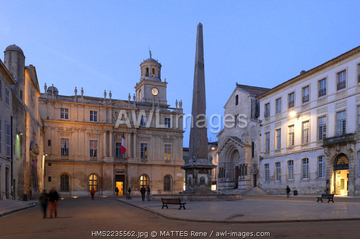 France, Bouches du Rhone, Arles, Place de la Republique, the clock tower of the city hall, the fountain obelisk and the Church of St Trophime of the 12th-15th century, listed as World Heritage by UNESCO