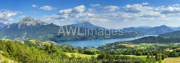 France, Hautes Alpes, Embrun, Panoramic view of the Lake of Serre Ponçon with the Peak of Morgon (2324m) on the left and the summit of Dormiouse (2500m) in the center