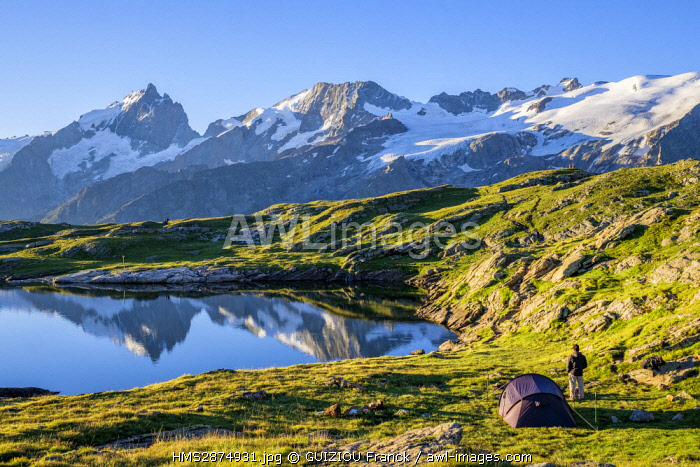 France, Hautes-Alpes, Oisans massif, hiking to the Plateau d'Emparis on the GR 54, the Meije massif is reflected in the Black Lake (alt: 2435m)