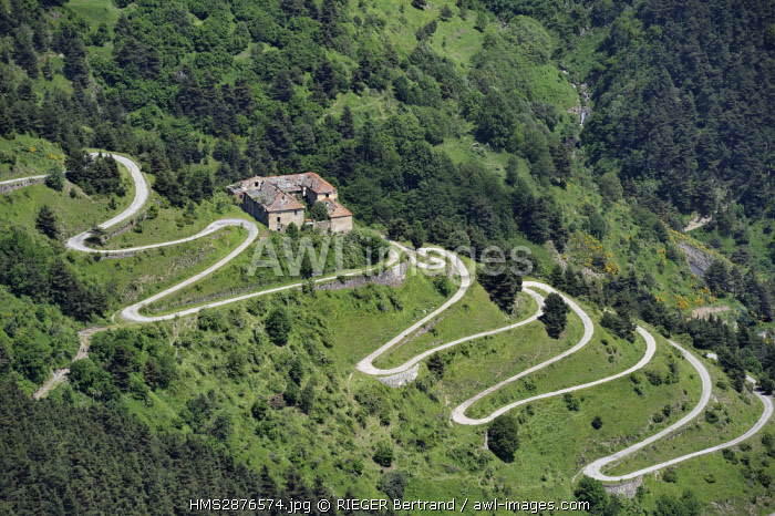 France, Alpes Maritimes, Tende, Roya Valley (Nice hinterland) seen from the Col (pass) de Tende and the laces of the old salt mules road, former inn dating from medieval times