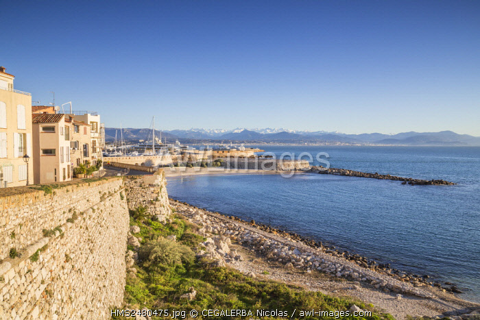 France, Alpes Maritimes, Gravette beach and the ramparts of the old town and in back ground the snowy South Alps