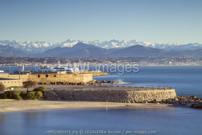France, Alpes Maritimes, Gravette beach, the monumental sculpture Nomade d'Antibes of the Catalan Jaume Plensa on the ramparts of the Vauban harbor and in back ground the snowy South Alps