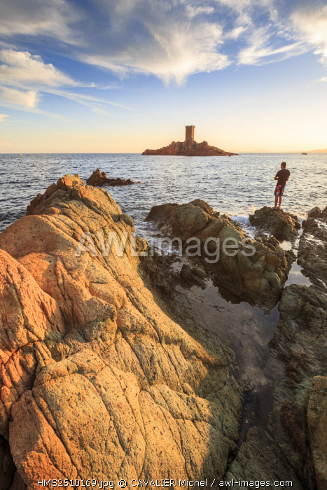 France, Var, Saint Raphael, a fisherman sinner to the Cap du Dramont, in the background the tower of the ile d'Or