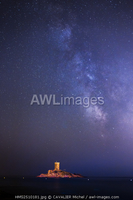France, Var, Saint Raphael, Cap of Dramont, the tower of the ile d'Or under the Milky Way seen by the port of Poussai