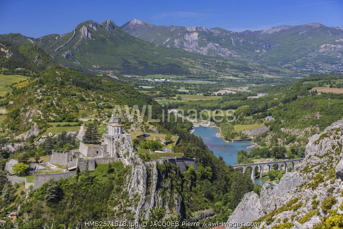 France, Alpes de Haute Provence, Sisteron, the Citadel, XIV XVI century, historical monument, view of Le Buech and railroad bridge