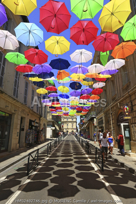 France, Bouches du Rhone, Arles, Jean Jaures street, installation of Patricia Cunha Colorful Umbrellas (Compulsory Mention)