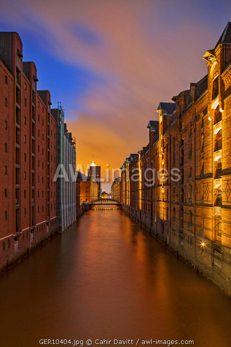 View of the Speicherstadt warehouse district, viewed from Kibbelstegbrucke at sunset, Speicherstadt, Hamburg, Germany.