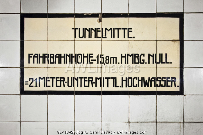 Tile plaque in the Alter Elbtunnel marking the mid point of beneath the River Elbe, Hamburg Mitte, Hamburg, Germany.
