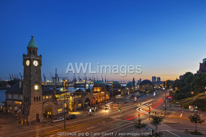 The St. Pauli Landungsbrucken and Blockbrau with Hamburg Port and the Elbe river in the background at sunset, Brucke 3, Hamburg, Germany.