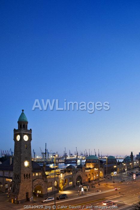The St. Pauli Landungsbrucken and Blockbrau with Hamburg Port and the Elbe river in the background at sunset, Brucke 3, Hamburg, Germany.