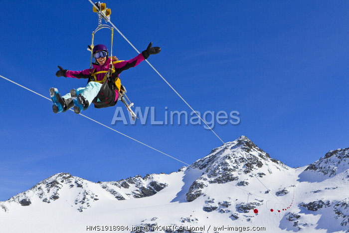 France, Savoie, Orelle, Val Thorens, Three Valleys ski area, ziplining the highest in the world (1300m long and 250m high), the departure is at 3250m altitude, woman