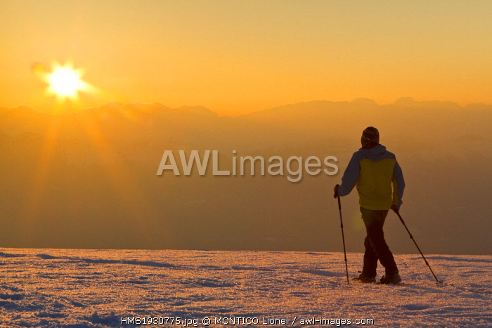 France, Isere, snowshoeing on the pastures of Senepy in the bottom of the Vercors massif