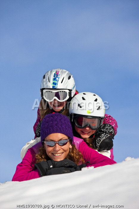 France, Isere, woman and child in winter sports