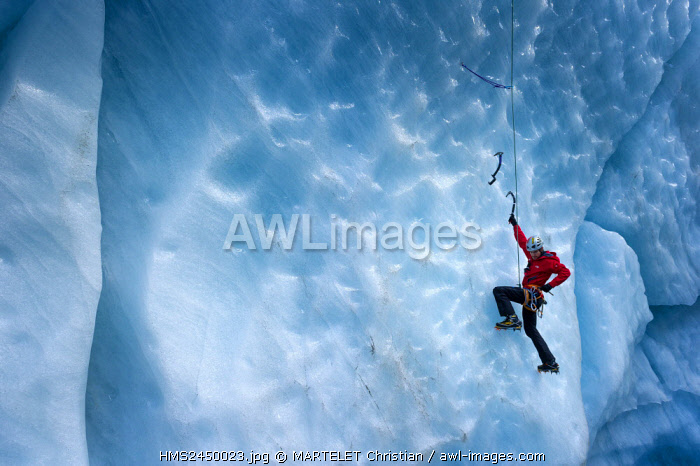 France, Haute Savoie, Chamonix, Ice Sea, Jessy Pivier aspiring ice climbing guide in the mills of the Mer de Glace