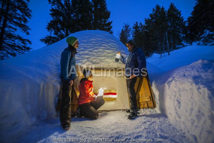 France, Haute-Savoie, Semnoz, Alpes Bivouac, Julien Perillat and his team amuse themselves around the igloos of his ecobivouac