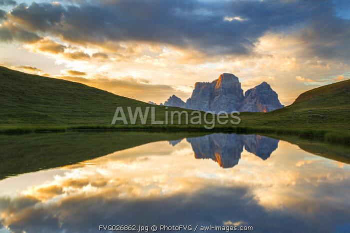 Pelmo mount reflected on Baste lake at twilight, Mondeval, Dolomites, Italy