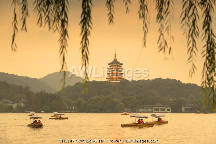 Leifeng Pagoda at dusk, West Lake (UNESCO World Heritage Site), Hangzhou, Zhejiang, China