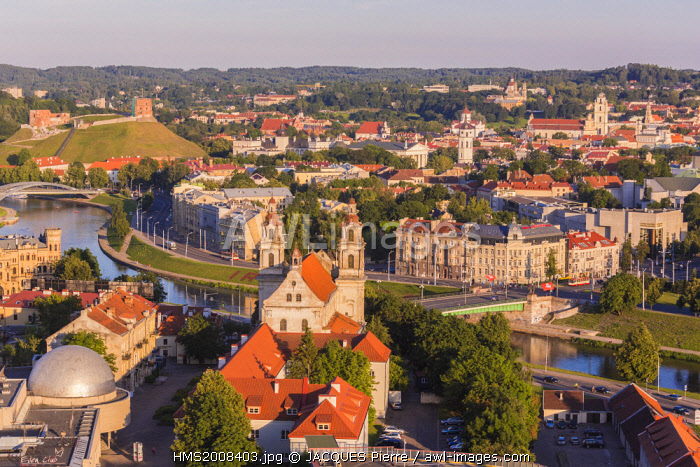 awl-images.com - Lithuania / Lithuania (Baltic States), Vilnius, historical center listed as World Heritage by UNESCO, seen on the bridge Zaliasis Titlas on the river Neris, the church of the Archangel Saint Raphaël in the foreground and the Gediminas tower upper left